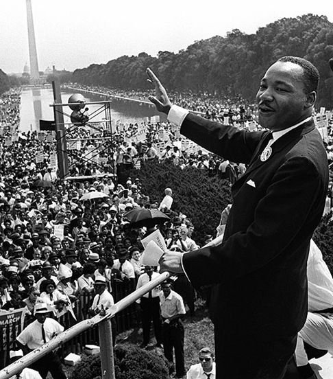 "The civil rights leader Martin Luther KIng (C) waves to supporters 28 August 1963 on the Mall in Washington DC (Washington Monument in background) during the ""March on Washington"". King said the march was ""the greatest demonstration of freedom in the history of the United States."" Martin Luther King was assassinated on 04 April 1968 in Memphis, Tennessee. James Earl Ray confessed to shooting King and was sentenced to 99 years in prison. King's killing sent shock waves through American society at the time, and is still regarded as a landmark event in recent US history. AFP PHOTO (Photo credit should read -/AFP/Getty Images)"